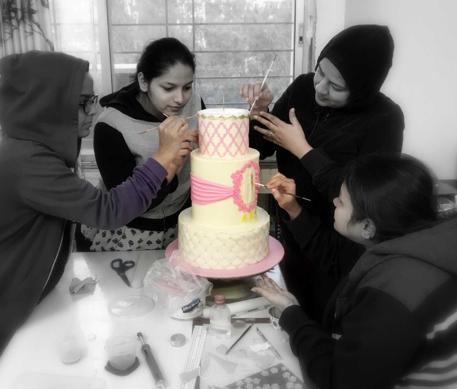 Sweet Mantra team working on Engagement cake in Pune