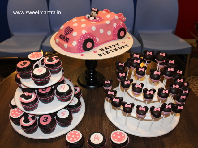 Minnie mouse theme dessert/sugar table with Minnie in car cake for girl's 3rd birthday in Pune