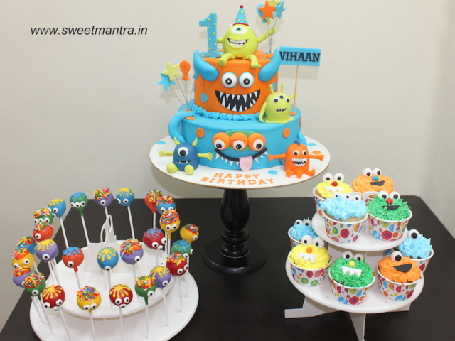 Cute Monsters theme colorful dessert/sugar table with fondant cake, cupcakes and cakepops for boy's 1st birthday in Pune