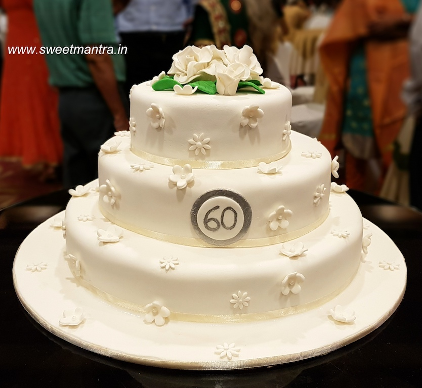 3 layer designer cake with white flowers for 60th anniversary in Pune