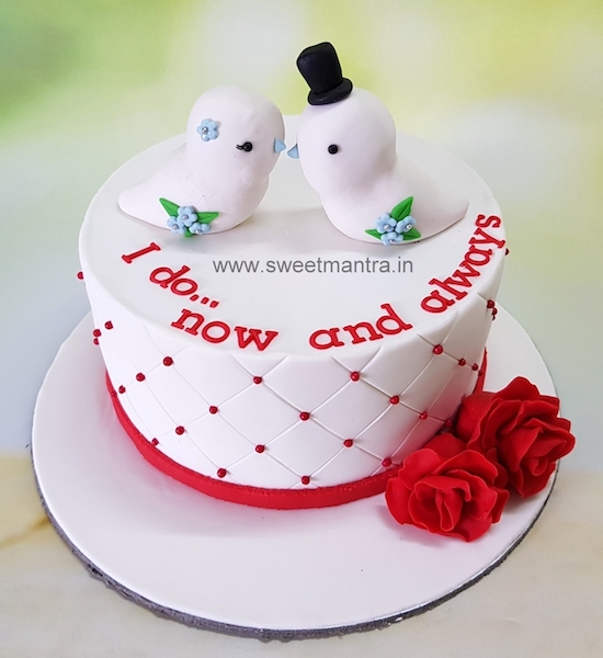 1st anniversary theme cake with 3D love birds in Pune