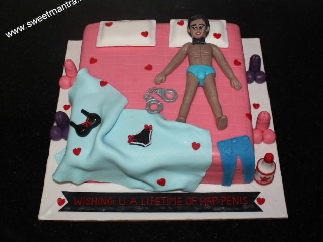 Bed shaped kinky 3D cake with male stripper, lingerie in Pune
