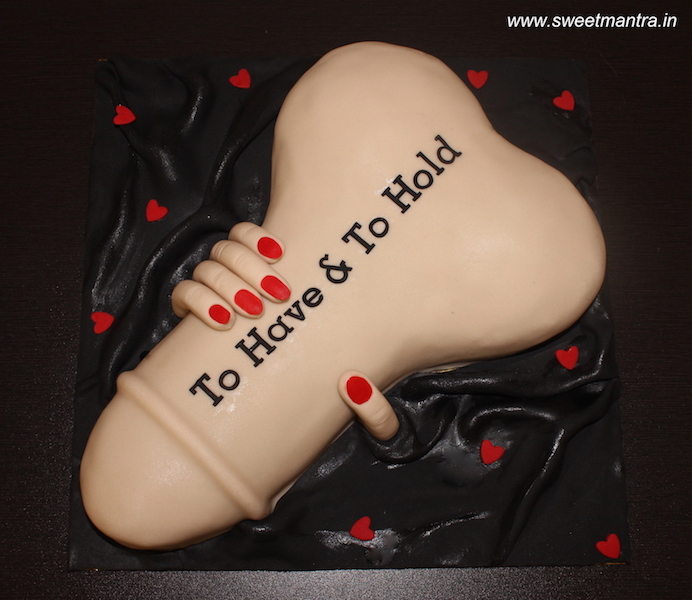 Hand holding Penis shaped 3D cake for bachelorette party in Pune