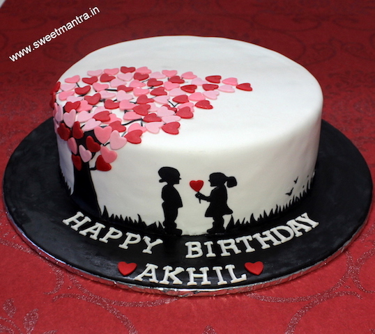 Love theme customized cake with cute boy and girl in Pune