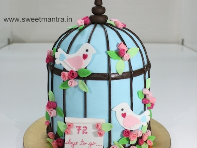Love birds cage shaped 3D designer cake for couple in Pune