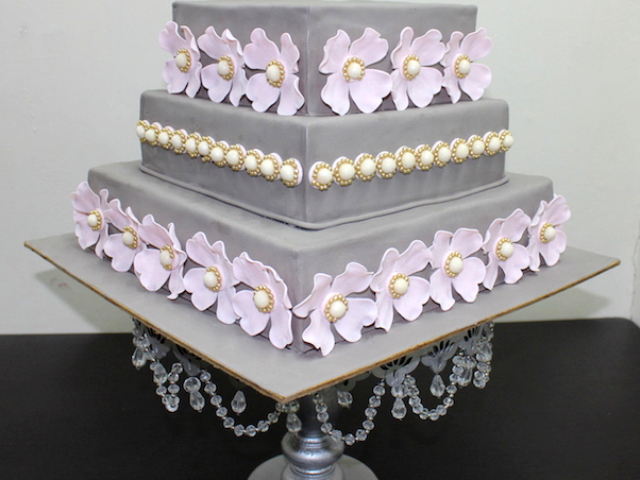 Flowers theme 3 layer designer fondant cake for Wedding in Pune