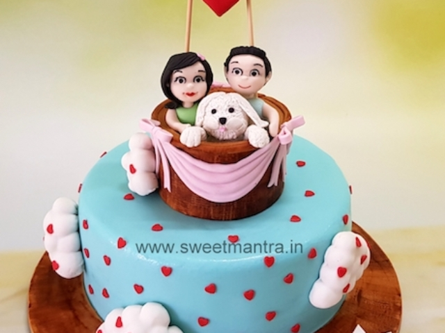Hot air balloon theme customized fondant cake for anniversary in Pune