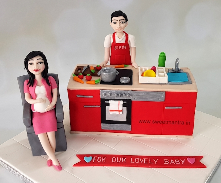 Kitchen Platform shaped 3D cake with husband cooking and pregnant lady relaxing theme for Baby Shower in Pune