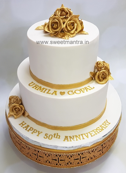 White and Gold theme 2 tier designer cake for parents 50th anniversary in Pune
