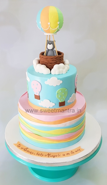 Hot air balloon theme 2 tier designer cake with pastel colors for baby shower in Pune