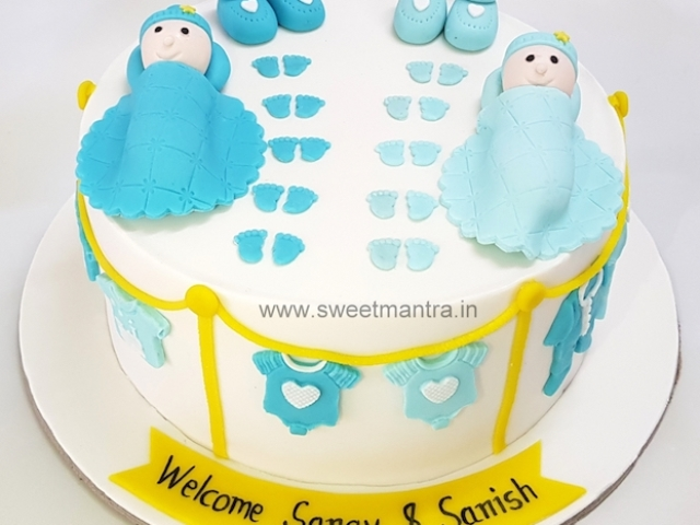 Customized designer cake for welcoming newborn twin boys in Pune