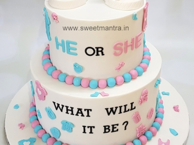 2 tier customized fondant cake with baby shoes in pink and blue for baby shower in Pune