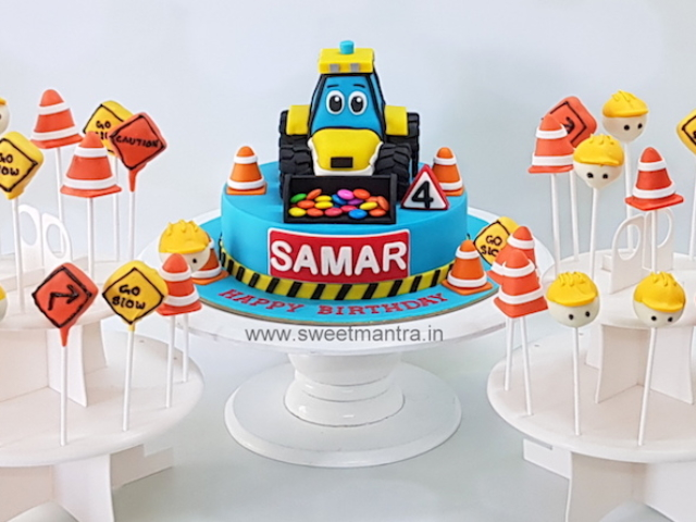 Construction theme dessert/sugar table with cute JCB cake, cake pops for boy's 4th birthday in Pune