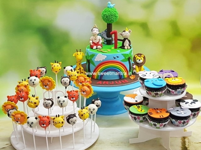 Animals, Jungle theme dessert table with customised cake, cupcakes n cake pops for 1st birthday in Pune