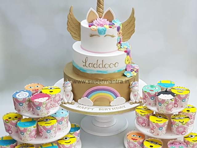 Unicorn theme dessert table with customised cake, Minions cupcakes for birthday in Pune
