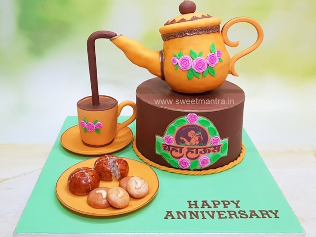 Teapot theme gravity defying cake for anniversary of Chaha House company in Pune