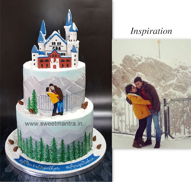 Winter theme hand painted wedding cake with Germany's Neuschwanstein Castle topper in Pune